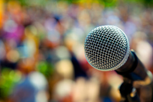 Microphone-and-audienceEvergreen-Partners