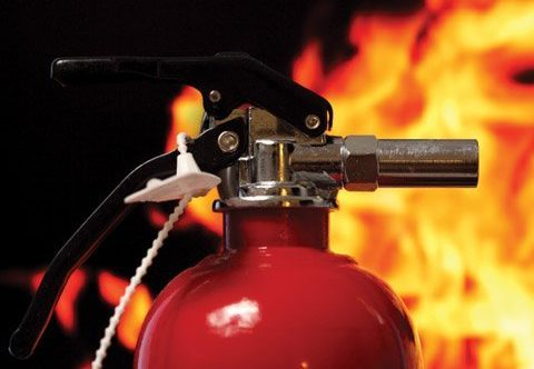 Fire Extinguisher (close Up) With Fire In The Background